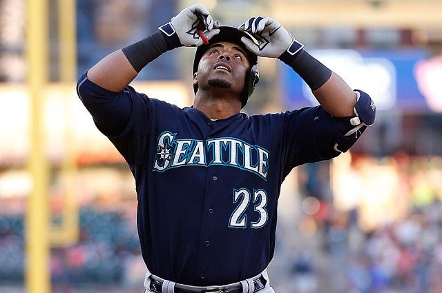 DETROIT, MI - JULY 22: Nelson Cruz #23 of the Seattle Mariners celebrates after hitting a two run home run scoring Kyle Seager #15 (not in photo) during the fourth inning of the game against the Detroit Tigers  July 22, 2015 at Comerica Park in Detroit, Michigan. (Photo by Leon Halip/Getty Images)
