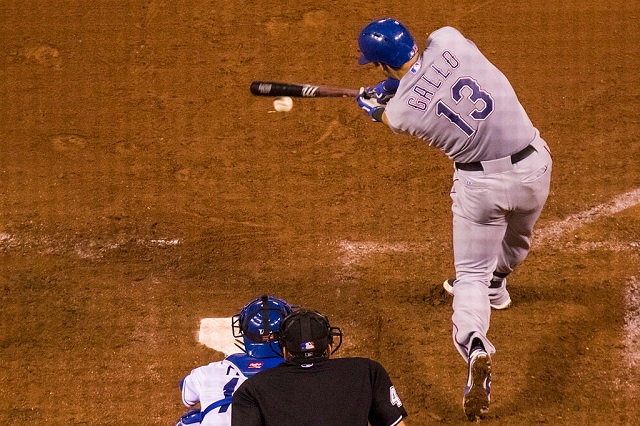 KANSAS CITY, MO - JUNE 05: Joey Gallo #13 of the Texas Rangers connects on a pitch from Luke Hochevar #44 of the Kansas City Royals in the eighth inning at Kauffman Stadium on June 5, 2015 in Kansas City, Missouri. (Photo by Kyle Rivas/Getty Images)