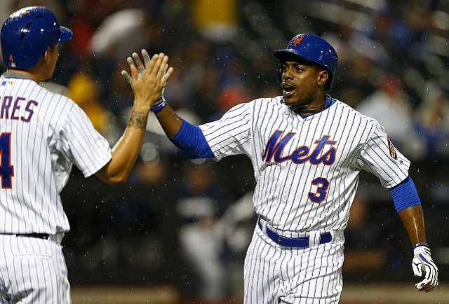 NEW YORK, NY - MAY 16: Curtis Granderson #3 of the New York Mets is congratulated by teammate Wilmer Flores #4 after hitting a two run home run in the seventh inning against the Milwaukee Brewers on May 16, 2015 at Citi Field in the Flushing neighborhood of the Queens borough of New York City. The Mets defeated the Brewers 14-1. (Photo by Rich Schultz/Getty Images)