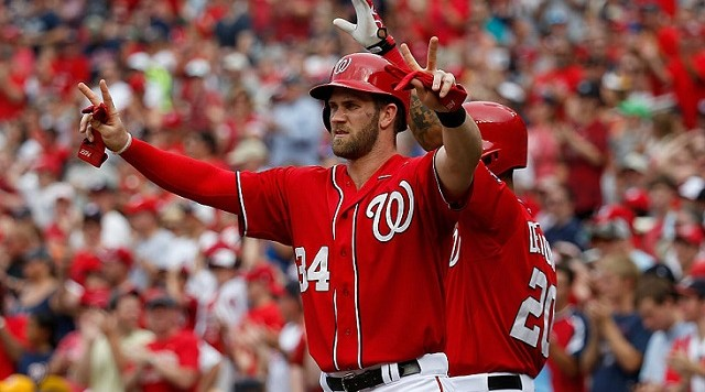 WASHINGTON, DC - JUNE 20: Bryce Harper #34 of the Washington Nationals celebrates after scoring in the sixth inning against the Pittsburgh Pirates during the Nationals 6-0 win at Nationals Park on June 20, 2015 in Washington, DC. (Photo by Rob Carr/Getty Images)