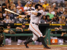 PITTSBURGH, PA - AUGUST 21:  Brandon Belt #9 of the San Francisco Giants hits a RBI double off the right field wall in the fourth inning during the game against the Pittsburgh Pirates at PNC Park on August 21, 2015 in Pittsburgh, Pennsylvania.  (Photo by Justin K. Aller/Getty Images)