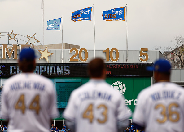 KANSAS CITY, MISSOURI - APRIL 05:  Players look toward a 2015 World Series Championship banner after receiving their rings during a ring ceremony prior to the game between the Royals and the New York Mets at Kauffman Stadium on April 5, 2016 in Kansas City, Missouri.  (Photo by Jamie Squire/Getty Images)