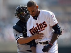 MINNEAPOLIS, MN - APRIL 14: Dioner Navarro #27 of the Chicago White Sox checks on Byron Buxton #25 of the Minnesota Twins after he was hit by a pitch during the third inning of the game on April 14, 2016 at Target Field in Minneapolis, Minnesota. The White Sox defeated the Twins 3-1. (Photo by Hannah Foslien/Getty Images)