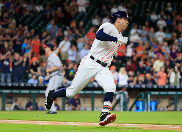 HOUSTON, TX - MAY 03:  Carlos Correa #1 of the Houston Astros reaches base on a two-run double in the third inning of their game against the Minnesota Twins at Minute Maid Park on May 3, 2016 in Houston, Texas.  (Photo by Scott Halleran/Getty Images)
