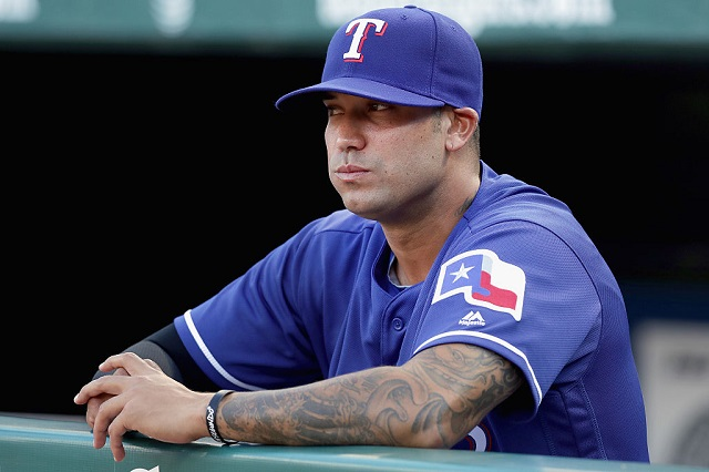 ARLINGTON, TX - MAY 13: Matt Bush #51 of the Texas Rangers sits in the dugout before the Texas Rangers take on the Toronto Blue Jays at Globe Life Park in Arlington on May 13, 2016 in Arlington, Texas. (Photo by Tom Pennington/Getty Images)