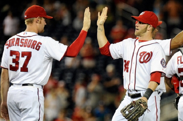 WASHINGTON, DC - JULY 03:  Bryce Harper #34 of the Washington Nationals celebrates with Stephen Strasburg #37 after a victory against the San Francisco Giants at Nationals Park on July 3, 2012 in Washington, DC.  (Photo by G Fiume/Getty Images)