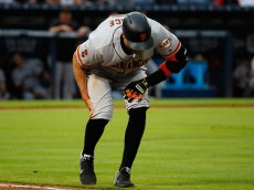ATLANTA, GA - JUNE 01:  Hunter Pence #8 of the San Francisco Giants grabs his right leg pullling up short running to first base on a ground out in the fourth inning against the Atlanta Braves at Turner Field on June 1, 2016 in Atlanta, Georgia.  (Photo by Kevin C. Cox/Getty Images)