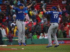 BOSTON, MA - JUNE 5:  Roberto Osuna #54 of the Toronto Blue Jays celebrates with Jose Bautista #19 after defeating the Boston Red Sox, 5-4, at Fenway Park on June 5, 2016 in Boston, Massachusetts. (Photo by Jim Rogash/Getty Images)