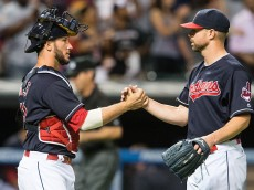 CLEVELAND, OH -  JUNE 21: Catcher Yan Gomes #10 celebrates with starting pitcher Corey Kluber #28 of the Cleveland Indians after the Indians defeated the Tampa Bay Rays 6-0 at Progressive Field on June 21, 2016 in Cleveland, Ohio. (Photo by Jason Miller/Getty Images)  *** Local Caption *** Yan Gomes; Corey Kluber