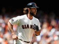 SAN FRANCISCO, CA - JUNE 28: Madison Bumgarner #40 of the San Francisco Giants rounds the bases after hitting a home run in the seventh inning against the Colorado Rockies at AT&T Park on June 28, 2015 in San Francisco, California.  (Photo by Lachlan Cunningham/Getty Images) *** Local Caption *** Madison Bumgarner