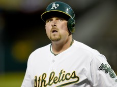 OAKLAND, CA - APRIL 06:  Billy Butler #16 of the Oakland Athletics reacts after striking out against the Texas Rangers in the bottom of the first inning on Opening Day at O.co Coliseum on April 6, 2015 in Oakland, California.  (Photo by Thearon W. Henderson/Getty Images)
