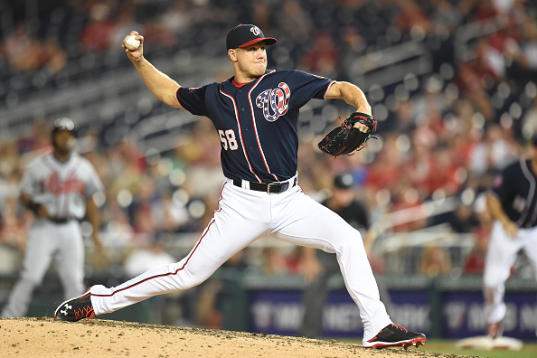 WASHINGTON, DC - SEPTEMBER 04:  Jonathan Papelbon #58 of the Washington Nationals pitches in the tenth inning for the win during a baseball game against the Atlanta Braves at Nationals Park on September 4, 2015 in Washington, DC.  The Nationals won 5-2 in the 10th inning.  (Photo by Mitchell Layton/Getty Images)