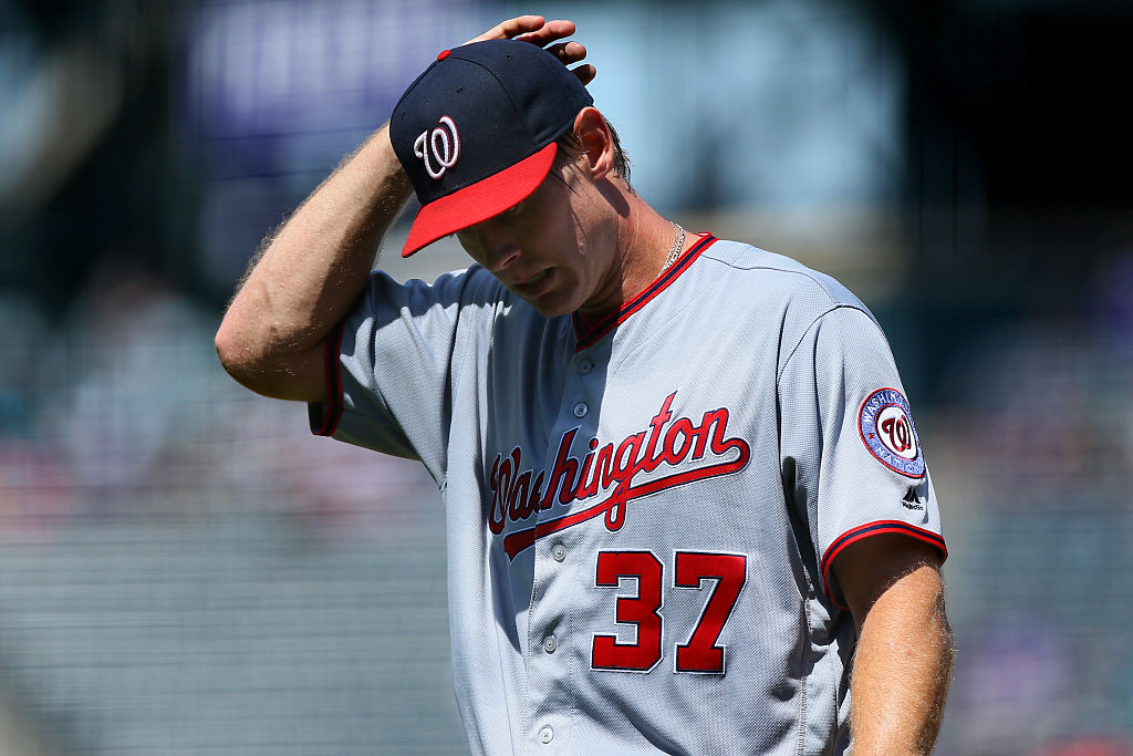 DENVER, CO - AUGUST 17:  Starting pitcher Stephen Strasburg #37 of the Washington Nationals walks off the field after allowing seven earned runs in the first inning against the Colorado Rockies at Coors Field on August 17, 2016 in Denver, Colorado. (Photo by Justin Edmonds/Getty Images)