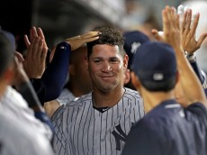 NEW YORK, NY - AUGUST 26: Gary Sanchez #24 of the New York Yankees is congratulated in the dugout after hitting a 2-run home run during the fifth inning against the Baltimore Orioles at Yankee Stadium on August 26, 2016 in the Bronx borough of New York City. (Photo by Adam Hunger/Getty Images)