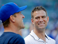 CHICAGO, IL - JULY 27: Theo Epstein (R), President of Operations for the Chicago Cubs, talks with head football coach Jim Harbaugh of the University of Michigan before the game between the Chicago White Sox and the Chicago Cubs at Wrigley Field on July 27, 2016 in Chicago, Illinois.  (Photo by Jon Durr/Getty Images)
