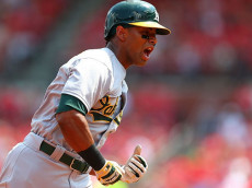 ST. LOUIS, MO - AUGUST 28: Khris Davis #2 of the Oakland Athletics celebrates after hitting a two-run home run against the St. Louis Cardinals in the first inning at Busch Stadium on August 28, 2016 in St. Louis, Missouri.  (Photo by Dilip Vishwanat/Getty Images)