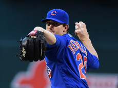 PHOENIX, ARIZONA - APRIL 09:  Kyle Hendricks #28 of the Chicago Cubs delivers a warm up pitch prior to the first inning against the Arizona Diamondbacks at Chase Field on April 9, 2016 in Phoenix, Arizona.  (Photo by Norm Hall/Getty Images)