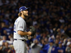 CHICAGO, IL - OCTOBER 22:  Clayton Kershaw #22 of the Los Angeles Dodgers reacts after a solo home run by Anthony Rizzo #44 of the Chicago Cubs (not pictured) in the fifth inning during game six of the National League Championship Series at Wrigley Field on October 22, 2016 in Chicago, Illinois.  (Photo by Jamie Squire/Getty Images)