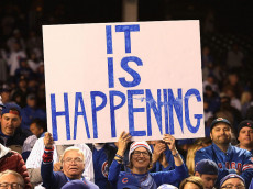 CHICAGO, IL - OCTOBER 22:  Chicago Cubs fans hold a sign after the Chicago Cubs defeated the Los Angeles Dodgers 5-0 in game six of the National League Championship Series to advance to the World Series against the Cleveland Indians at Wrigley Field on October 22, 2016 in Chicago, Illinois.  (Photo by Jamie Squire/Getty Images)