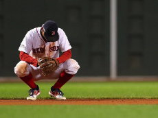 BOSTON, MA - OCTOBER 10: Xander Bogaerts #2 of the Boston Red Sox reacts in the ninth inning against the Cleveland Indians during game three of the American League Divison Series at Fenway Park on October 10, 2016 in Boston, Massachusetts. (Photo by Maddie Meyer/Getty Images)