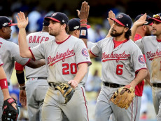 LOS ANGELES, CA - OCTOBER 10: Daniel Murphy #20 and Anthony Rendon #6 of the Washington Nationals celebrate after the final out as the Nationals defeat the Los Angeles Dodgers 8-3 in game three of the National League Division Series at Dodger Stadium on October 10, 2016 in Los Angeles, California. (Photo by Harry How/Getty Images)