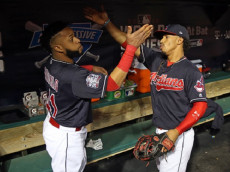 CLEVELAND, OH - NOVEMBER 2:  Francisco Lindor #12 and Carlos Santana #41 of the Cleveland Indians #12 get ready in the dugout prior to Game 7 of the 2016 World Series against the Chicago Cubs at Progressive Field on Wednesday, November 2, 2016 in Cleveland, Ohio. (Photo by Rob Tringali/MLB Photos via Getty Images) *** Local Caption *** Francisco Lindor;Carlos Santana