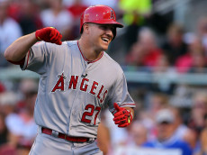 CINCINNATI, OH - JULY 14:  American League All-Star Mike Trout #27 of the Los Angeles Angels of Anaheim celebrates after hitting a lead off home run in the first inning against National League All-Star Zack Greinke #21 of the Los Angeles Dodgers during the 86th MLB All-Star Game at the Great American Ball Park on July 14, 2015 in Cincinnati, Ohio.  (Photo by Elsa/Getty Images)