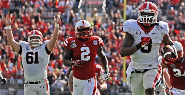 In January of 2013, Georgia beat Nebraska in a bowl game played in the state of Florida (the Capital One Bowl). Georgia wore visiting whites, Nebraska its home reds...