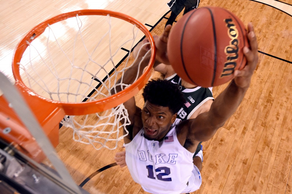 INDIANAPOLIS, IN - APRIL 04: Justise Winslow #12 of the Duke Blue Devils goes up for a dunk in the second half against the Michigan State Spartans during the NCAA Men's Final Four Semifinal at Lucas Oil Stadium on April 4, 2015 in Indianapolis, Indiana.  (Photo by Chris Steppig - Pool/Getty Images)