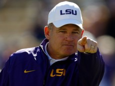 BATON ROUGE, LA - NOVEMBER 29:  Head coach Les Miles of the LSU Tigers reacts during pre game before playing the Arkansas Razorbacks at Tiger Stadium on November 29, 2013 in Baton Rouge, Louisiana.  (Photo by Chris Graythen/Getty Images)