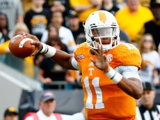 JACKSONVILLE, FL - JANUARY 02:  Joshua Dobbs #11 of the Tennessee Volunteers attempts a pass during the TaxSlayer Bowl against the Iowa Hawkeyes at EverBank Field on January 2, 2015 in Jacksonville, Florida.  (Photo by Sam Greenwood/Getty Images)