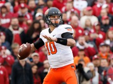 NORMAN, OK - DECEMBER 6:  Quarterback Mason Rudolph #10 of the Oklahoma State Cowboys looks to throw against the Oklahoma Sooners December 6, 2014 at Gaylord Family-Oklahoma Memorial Stadium in Norman, Oklahoma. The Cowboys defeated the Sooners 38-35 in overtime.  (Photo by Brett Deering/Getty Images)