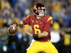 PASADENA, CA - NOVEMBER 22:  Quartreback Cody Kessler #6 of the USC Trojans throws a pass against the UCLA Bruins at the Rose Bowl on November 22, 2014 in Pasadena, California.  (Photo by Stephen Dunn/Getty Images)