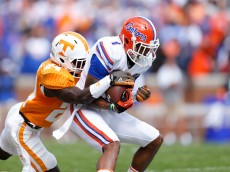 KNOXVILLE, TN - OCTOBER 4: Quinton Dunbar #1 of the Florida Gators makes a reception in front of Michael Williams #24 of the Tennessee Volunteers during the first half of the game at Neyland Stadium on October 4, 2014 in Knoxville, Tennessee. (Photo by Joe Robbins/Getty Images)