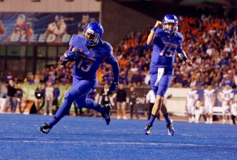 Boise State running back Jeremy McNichols (13) scores the game's first touchdown as Boise State quarterback Ryan Finley (15) celebrates against the University of Washington at Albertsons Stadium in Boise, Idaho, on Friday, Sept. 4. (Darin Oswald/Idaho Statesman/TNS via Getty Images)