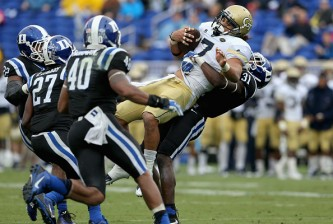 DURHAM, NC - SEPTEMBER 26:  Breon Borders #31 of the Duke Blue Devils tackles Patrick Skov #7 of the Georgia Tech Yellow Jackets during their game at Wallace Wade Stadium on September 26, 2015 in Durham, North Carolina.  (Photo by Streeter Lecka/Getty Images)