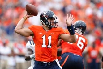 CHARLOTTESVILLE, VA - AUGUST 30: Greyson Lambert #11 of the Virginia Cavaliers passes the ball during first half action against the UCLA Bruins at Scott Stadium on August 30, 2014 in Charlottesville, Virginia. (Photo by Joe Robbins/Getty Images)