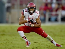 PALO ALTO, CA - NOVEMBER 15:  Devontae Booker #23 of the Utah Utes carries the ball against the Stanford Cardinal in the second quarter at Stanford Stadium on November 15, 2014 in Palo Alto, California.  (Photo by Thearon W. Henderson/Getty Images)