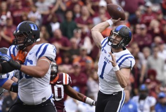 BLACKSBURG, VA - OCTOBER 24: Quarterback Thomas Sirk #1 of the Duke Blue Devils throws a pass against the Virginia Tech Hokies in the first half at Lane Stadium on October 24, 2015 in Blacksburg, Virginia. Duke defeated Virginia Tech 45-43 in quadruple overtime. (Photo by Michael Shroyer/Getty Images)