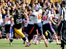 IOWA CITY, IA - OCTOBER 10: Defensive lineman Nathan Bazata #99 of the Iowa Hawkeyes puts pressure on quarterback Wes Lunt #12 of the Illinois Fighting Illini in the first half of play at Kinnick Stadium on October 10, 2015 in Iowa City, Iowa. (Photo by David Purdy/Getty Images).