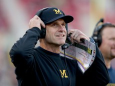 BLOOMINGTON, IN - NOVEMBER 14:  Jim Harbaugh the head coach of the Michigan Wolverines watches the action against the Indiana Hoosiers at Memorial Stadium on November 14, 2015 in Bloomington, Indiana.  (Photo by Andy Lyons/Getty Images)