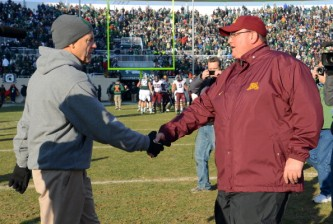 EAST LANSING, MI - NOVEMBER 30:  Michigan State Spartans head coach Mark Dantonio shakes hands with Minnesota Golden Gophers acting head coach Tracy Claeys at the end of the game at Spartan Stadium on November 30, 2013 in East Lansing, Michigan. The Spartans defeated the Golden Gophers 14-3.  (Photo by Mark A. Cunningham/Getty Images)
