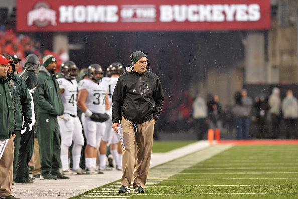COLUMBUS, OH - NOVEMBER 21:  Head Coach Mark Dantonio of the Michigan State Spartans watches from the sideline as his team plays against the Ohio State Buckeyes in the first half at Ohio Stadium on November 21, 2015 in Columbus, Ohio.  (Photo by Jamie Sabau/Getty Images)