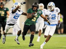 ORLANDO, FL - DECEMBER 29: Johnny Jefferson #5 of the Baylor Bears carries while defended by Dominquie Green #26 and Des Lawrence #2 of the North Carolina Tar Heels during the first half of the Russell Athletic Bowl game at Orlando Citrus Bowl on December 29, 2015 in Orlando, Florida.  (Photo by Rob Foldy/Getty Images)