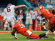 MIAMI GARDENS, FL - DECEMBER 31:  Baker Mayfield #6 of the Oklahoma Sooners is sacked by Shaq Lawson #90 of the Clemson Tigers in the first quarter during the 2015 Capital One Orange Bowl at Sun Life Stadium on December 31, 2015 in Miami Gardens, Florida.  (Photo by Mike Ehrmann/Getty Images)