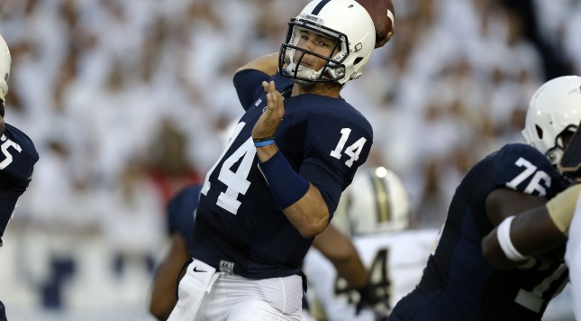 Penn State quarterback Christian Hackenberg (14) passes during the first quarter of an NCAA college football game against Central Florida in State College, Pa., Saturday, Sept. 14, 2013. UCF  won 34-31. (AP Photo/Gene J. Puskar)