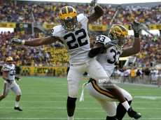 Michigan defensive back Jared Wilson (22) celebrates with teammate Taco Charleton (33) after Wilson intercepted a pass in the end zone against Florida during the second quarter in the Buffalo Wild Wings Citrus Bowl at the Orlando Citrus Bowl in Orlando, Fla., on Friday, Jan. 1, 2016. (Joe Burbank/Orlando Sentinel/TNS)
