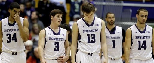 Northwestern players react as they walk on the court during the second half of an NCAA college basketball game against Wisconsin in Evanston, Ill., on Thursday, Jan. 2, 2014. Wisconsin won 76-49. (AP Photo/Nam Y. Huh)