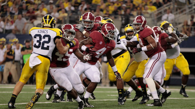 ARLINGTON, TX - SEPTEMBER 01: T. J. Yeldomn #4 of the University of Alabama runs for a short gain during the first quarter of the game against the University of Michigan at Cowboys Stadium on September 1, 2012 in Arlington, Texas. Alabama defeated Michigan 41-14.  (Photo by Leon Halip/Getty Images)