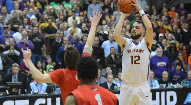 PATRICK DODSON/GAZETTE PHOTOGRAPHER  UAlbany's Peter Hooley (12) shoots a buzzer beater three pointer to beat Stony Brook in the America East championship game at University at Albany's SEFCU Arena on Saturday, March 14, 2015.